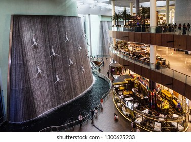 Dubai, UAE - Jan 31, 2019: Dubai Mall trade center. Waterfall with pearl divers.