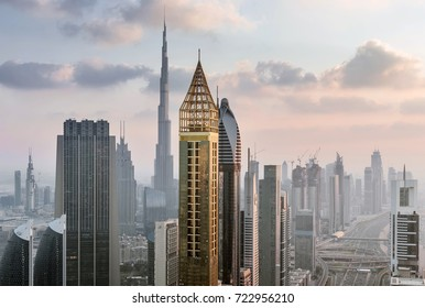 DUBAI, UAE - JAN 8, 2017: Burj Khalifa, Rose Rayhaan by Rotana, Ahmed Abdul Rahim Al Attar Tower, Sheikh Zayed Highway