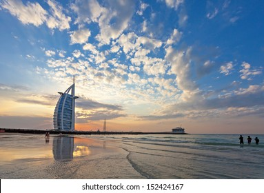 DUBAI, UAE, JANUARY 1: Burj Al Arab on Jumeirah Beach after a big thunderstorm. After the storm all what remains are spectacular clouds in the sky. New Years Day January 01, 2010