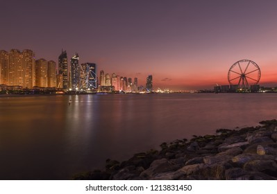 Dubai, UAE - January 10, 2018: Jumeirah Beach Residence JBR   and Dubai Ferris Wheel  with night illumination.