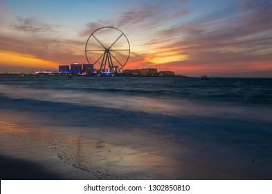 Dubai, UAE - January 10, 2019: Dubai Eye is the world's highest observation wheel against sunset