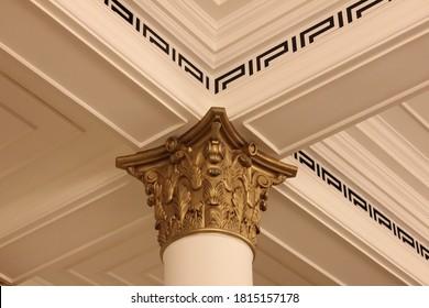 Dubai, UAE - January 11, 2021: Gilded Roman pillar column (Corinthian style)at Palazzo Versace Dubai hotel. The 5-star hotel features grand Italian design and signature Versace brand elements.