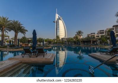 Dubai, UAE - January 12, 2018:Beautiful pool  hotel Al Naseem Madinat Jumeirah with view of Burj Al Arab Hotel
