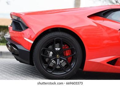 DUBAI, UAE - JANUARY 13, 2017: Red luxury supercar Lamborghini Aventador Roadster car on the road in Dubai
