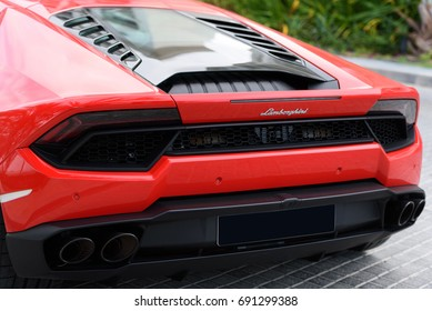 DUBAI, UAE - JANUARY 13, 2017: Red luxury supercar Lamborghini Aventador Roadster car on the road in Dubai