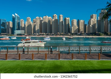 Dubai, UAE - January 14, 2019: New boardwalk on the Bluewaters Island overlooking the bay and Jumeirah Beach Residence.