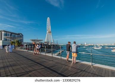 Dubai, UAE - January 16, 2019: New Pedestrian Bridge on the Bluewaters Island and Dubai Eye.