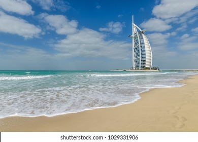 Dubai, UAE - January 21, 2018: Beautiful sandy beach Madinat Jumeirah with view of the Burj Al Arab hotel