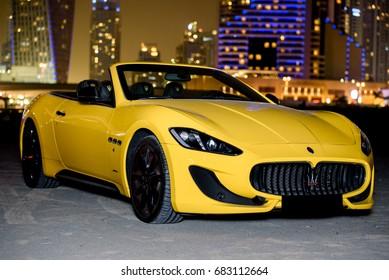DUBAI, UAE - JANUARY 23, 2017: Yellow luxury supercar Maserati granturismo on the road in Dubai