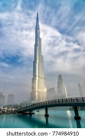 DUBAI, UAE - JANUARY 24, 2016: A new day dawns at the world's tallest building- the Burj khalifa.  The tower is one of Dubai's top visitor destinations, on January, 24 2016 in Dubai, UAE.