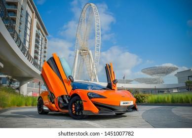 Dubai / UAE - January 29, 2019: Orange McLaren 570S car in Dubai Bluewaters Island