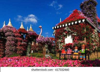Dubai, UAE - January 5, 2017. Dubai Miracle Garden -Flower House and ostrich in the foreground. Dubai Miracle Garden is the largest natural flower garden in the world