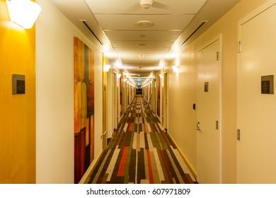 Dubai, UAE, January, 5th, 2017, Golden corridor with carpet and closed doors at the hotel of Ibis, United Arab Emirates