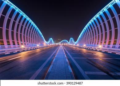 Dubai, UAE July, 19 2015, Meydan Bridge at night with natural architectural mirror