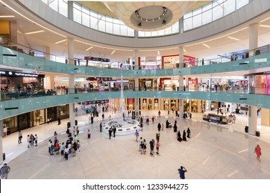 Dubai, UAE - July 19, 2018: People inside the Grand Atrium inside Dubai Mall