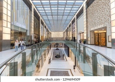 Dubai, UAE - July 19, 2018: People inside an atrium inside Dubai Mall. The Dubai Mall, also known as the home of the Dubai shopping festival, is one of the world's largest shopping malls in UAE.