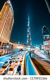 DUBAI, UAE - JULY, 2018: Downtown Dubai at night. Leading lines to Burj Khalifa. Emaar hotel. Luxury travel middle east.