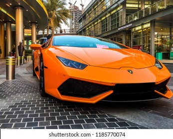 Dubai, UAE - July 25, 2015: Dubai Mall - epic orange Lamborghini Huracan outside Dubai Mall