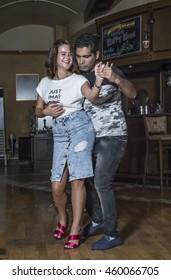Dubai, UAE - July 26th 2016: salsa dancers on a dance floor