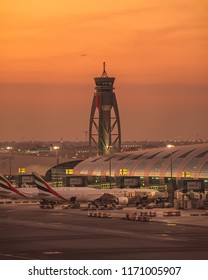 DUBAI, UAE - JULY,2018: Dubai airport during a beautiful sunset. Aviation scene. Emirates Airlines. Travel inspiration.
