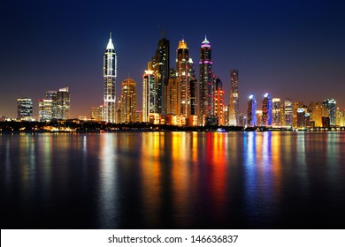 DUBAI, UAE - JUN 25: Dubai Marina skyline as seen from Palm Jumeirah on Jun 25, 2013 in Dubai, UAE. This part of Dubai has more skyscrapers over 50 stories that Manhattan