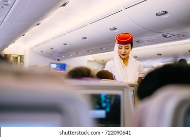 Emirates Airline Cabin Crew Images, Stock Photos & Vectors