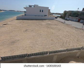 Dubai UAE - June 2019: Empty reclamation, compact land. Land plot for sales and real estate development project concept background.