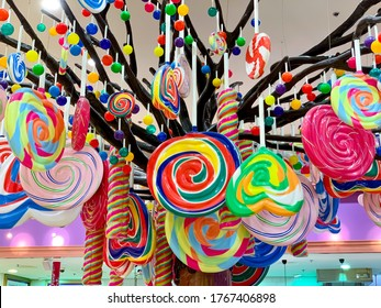 DUBAI, UAE - JUNE, 2020: Big tree with multicolor sweets and colorfull lollypops in Candylicious shop, the biggest candy store in the world in the Dubai Mall in UAE