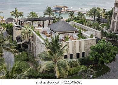 DUBAI, UAE - JUNE 26, 2016: Beautiful green area of 5-stars Sofitel Dubai The Palm Resort & Spa - luxurious resort (361 rooms) on Palm Jumeirah in Dubai. Polynesian design combines with French flair.