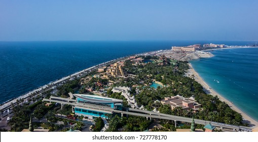 DUBAI, UAE - JUNE 26, 2016: Aerial views of man-made island Palm Jumeirah and famous Aquaventure waterpark of Atlantis the Palm hotel.