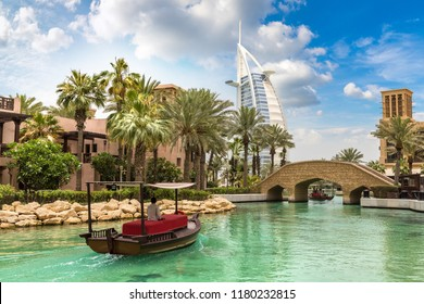 DUBAI, UAE - JUNE 26, 2018: View at Burj Al arab hotel from Madinat Jumeirah luxury hotel in a summer day in Dubai, United Arab Emirates