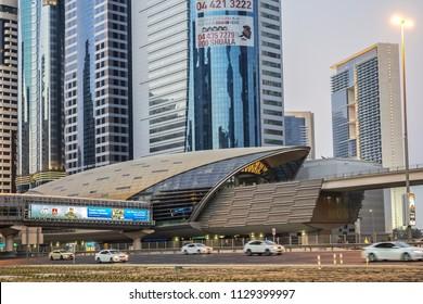 DUBAI, UAE - JUNE 27, 2016: View of Sheikh Khalifa Bin Zayed road traffic and buildings at sunset. Sheikh Khalifa Bin Zayed road (Khalifa Street) is the main artery of the city.