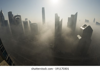 DUBAI, UAE - MAR 6: Dubai Skyline in Sheikh Zayed Road and Downtown is covered by early morning fog on March,6 2014 in Dubai, UAE