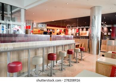 DUBAI, UAE - MARCH 10, 2015: BK restaurant interior. Burger King, often abbreviated as BK, is a global chain of hamburger fast food restaurants