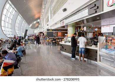 DUBAI, UAE - MARCH 10, 2015: DXB airport interior. Dubai International Airport is the primary airport serving Dubai, and is the world's busiest airport by international passenger traffic.