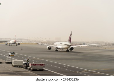 DUBAI, UAE - MARCH 10, 2015: jet aircraft in Dubai airport. Dubai International Airport is an international airport serving Dubai. It is a major airline hub in the Middle East