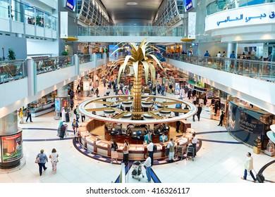 DUBAI, UAE - MARCH 10, 2015: inside of Dubai International Airport. Dubai International Airport is the primary airport serving Dubai, United Arab Emirates