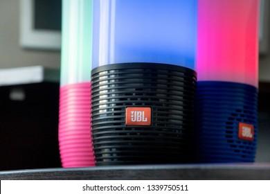DUBAI, UAE - MARCH 14, 2019: Three JBL bluetooth speakers close up in the hotel room