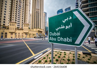 DUBAI, UAE - MARCH 16, 2015 : Sign board of Dubai & Abudhabi route at Jumeirah beach residence on March 16, 2015 in Dubai, JBR - artificial canal city, carved along a 3 km stretch of Persian Gulf.