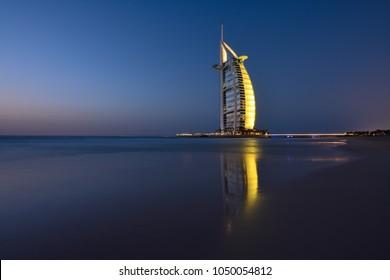 DUBAI, UAE - March 19 :The seven stars luxury hotel Burj Al Arab, captured after sunset on March 19, 2018 in Dubai, United Arab Emirates