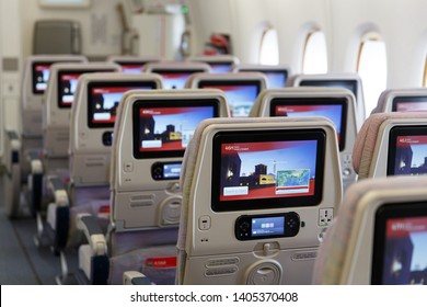 Dubai, UAE - March 20, 2015: Emirates new economy class seats with modern multimedia system and large screens of high resolution and touchscreen    , close up. Airbus A380 interior without passengers