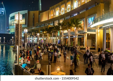 DUBAI, UAE - MARCH 2014: Tourists and visitors walking outside the Mall of Dubai, also known as the home of the Dubai shopping festival, is one of the world's largest shopping malls in UAE.