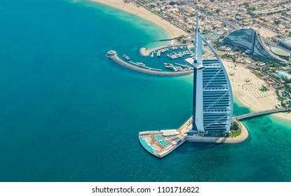 DUBAI, UAE - MARCH 2018: Aerial view of Burj Al Arab hotel in Dubai, one of the most luxury hotel in the world.