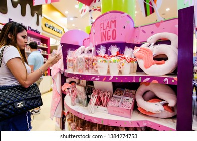 DUBAI, UAE - March, 2019: Beautiful pink flamingo gifts for girls are on the counter in the sweets shop Candylicious - Candy Store at The Dubai Mall, UAE
