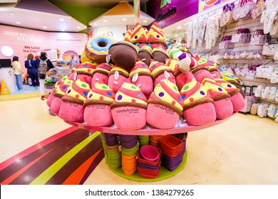 DUBAI, UAE - March, 2019: Beautiful pink cupcake soft toys for girls are on the counter in the sweets shop Candylicious - Candy Store at The Dubai Mall, UAE