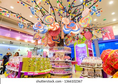 DUBAI, UAE - March, 2019: Big tree with multicolor sweets and colorfull lollypops in Candylicious shop, the biggest candy store in the world in the Dubai Mall in UAE
