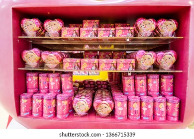 DUBAI, UAE - MARCH, 2019: A lot of pink iron boxes with chocolate and sweets Barbie sell in the candy store Candylicious in the Dubai Mall in UAE