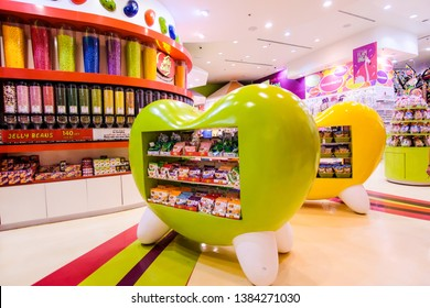 DUBAI, UAE - March, 2019: Yellow and green apple or heart shape counters with multicolor sweets in Candylicious shop, the biggest candy store in the world in the Dubai Mall in UAE