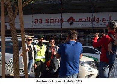 Dubai, uae - March 20,2019 : tourists taking photo along with a Dubai police officer in bur dubai.
