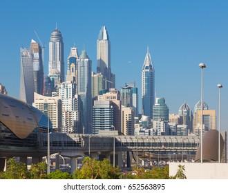 DUBAI, UAE - MARCH 22, 2017: The Marina towers and the rails of metro.